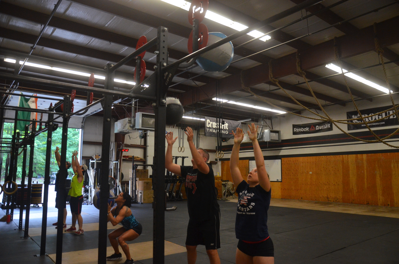 The noon class working through their 30 wall ball.