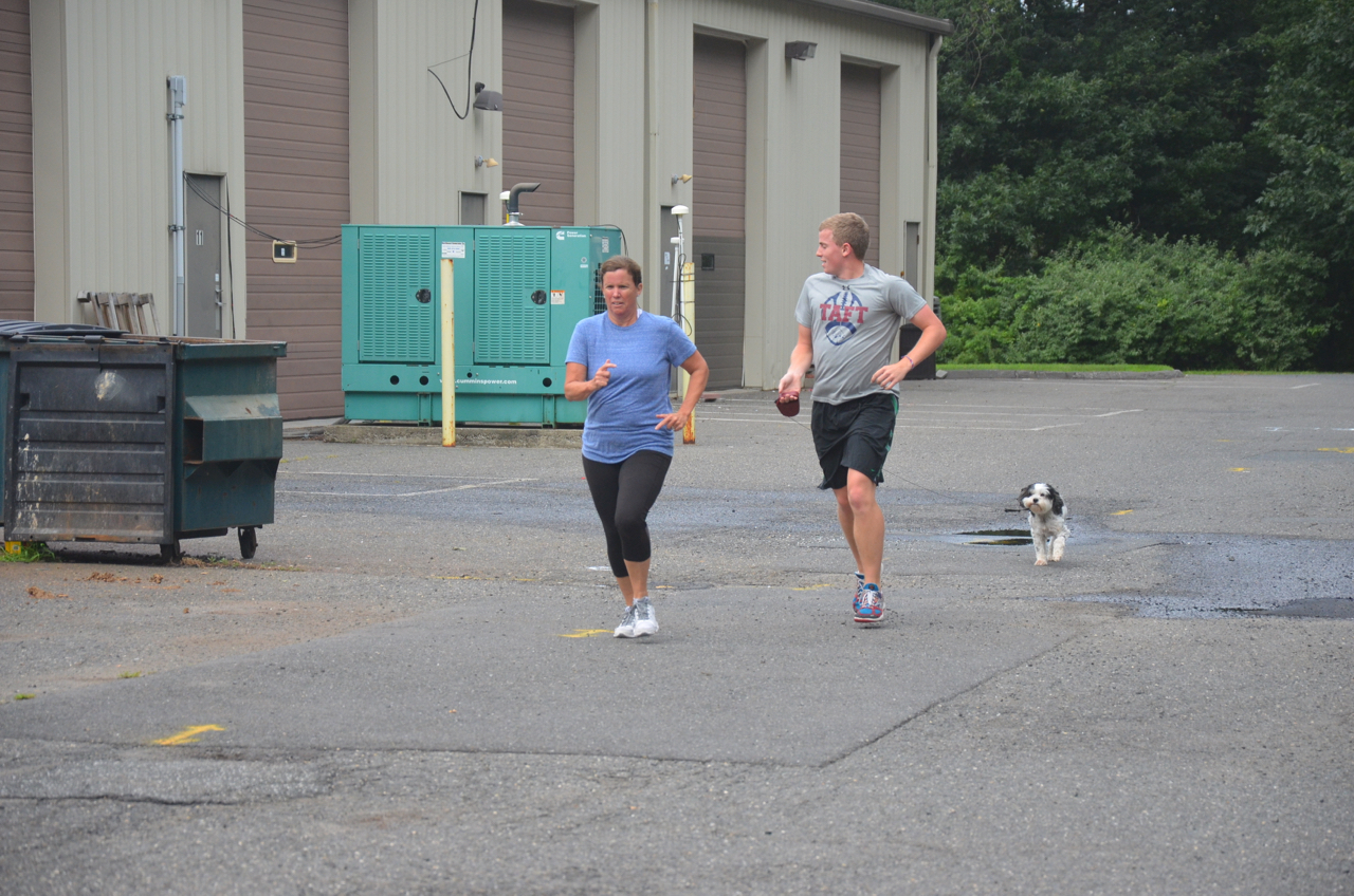 Susie finishing her run with a little support from Jon, and Foxy.