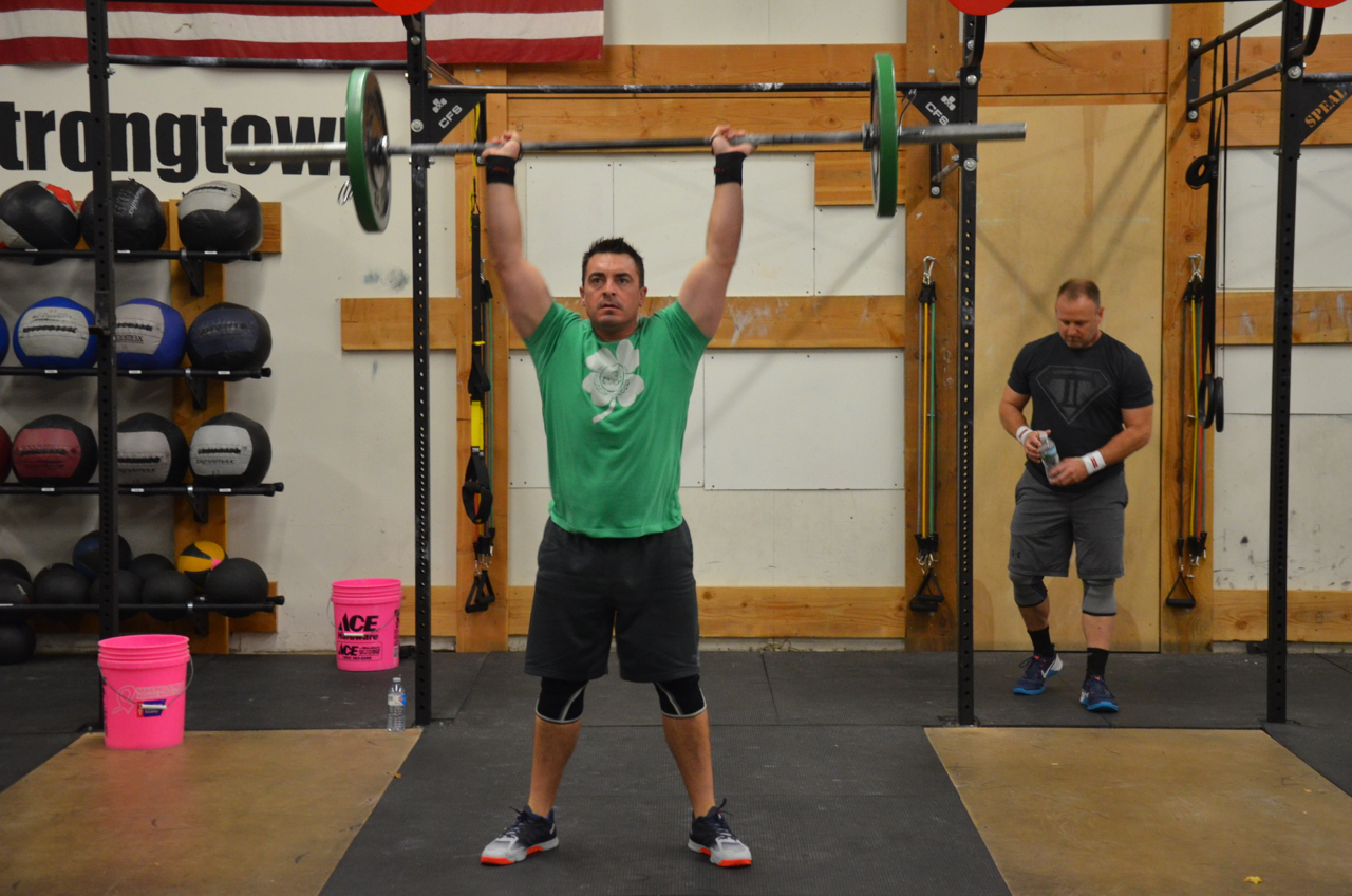 Brian staying focused during his Thrusters for the Sunday partner wod.