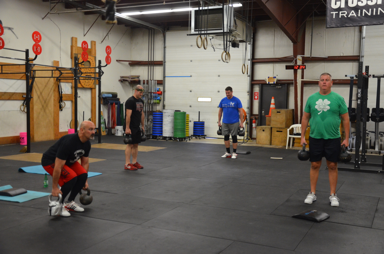 Doc, Jim, Barry and Gerry working through the Kettlebell deadlifts.