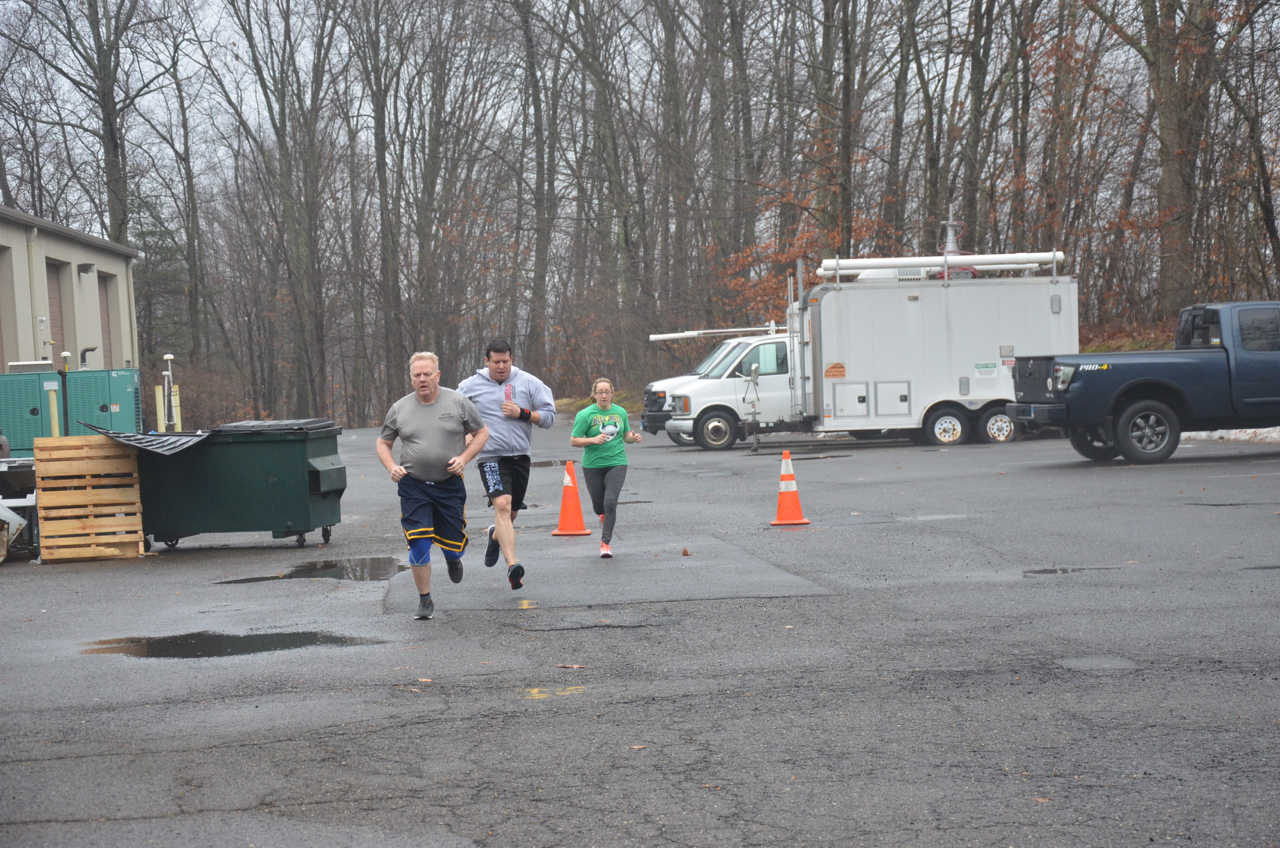 Kieth, Chris and Annette during Sunday's team wod. Welcome to Strongtown Keith!