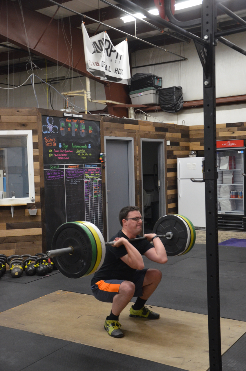 Jesse showing good depth on his front squat.