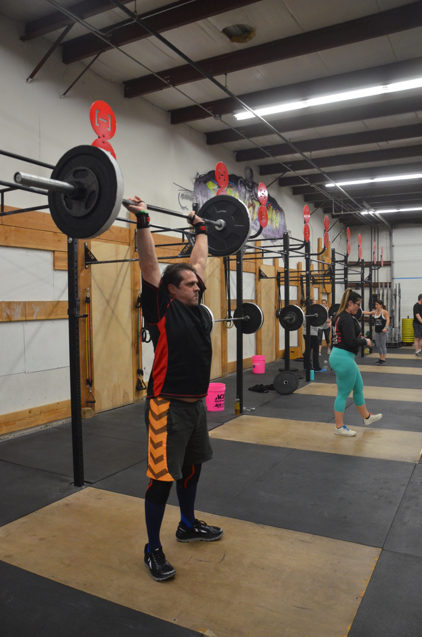 Truck working through his strength portion of Thrusters.