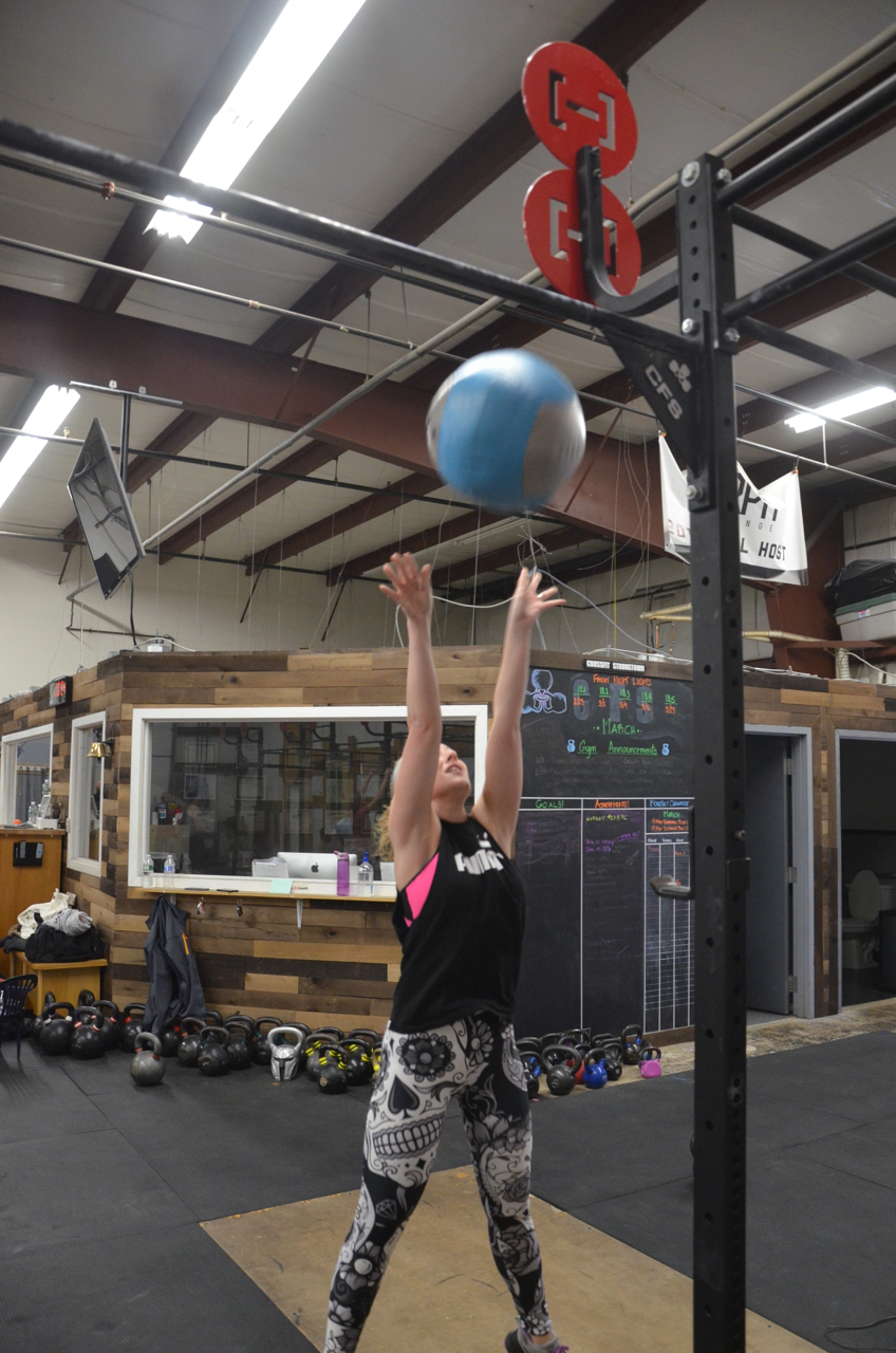 Stacy making sure to hit her target during her wall-ball.