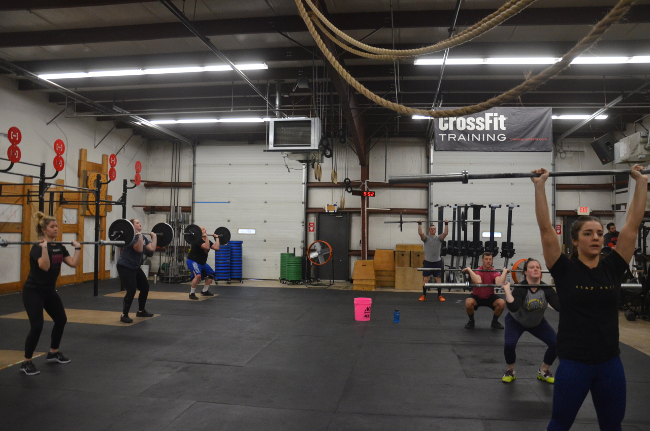 The 5pm class at the start of 65 Thrusters for time at 65/45 lbs.