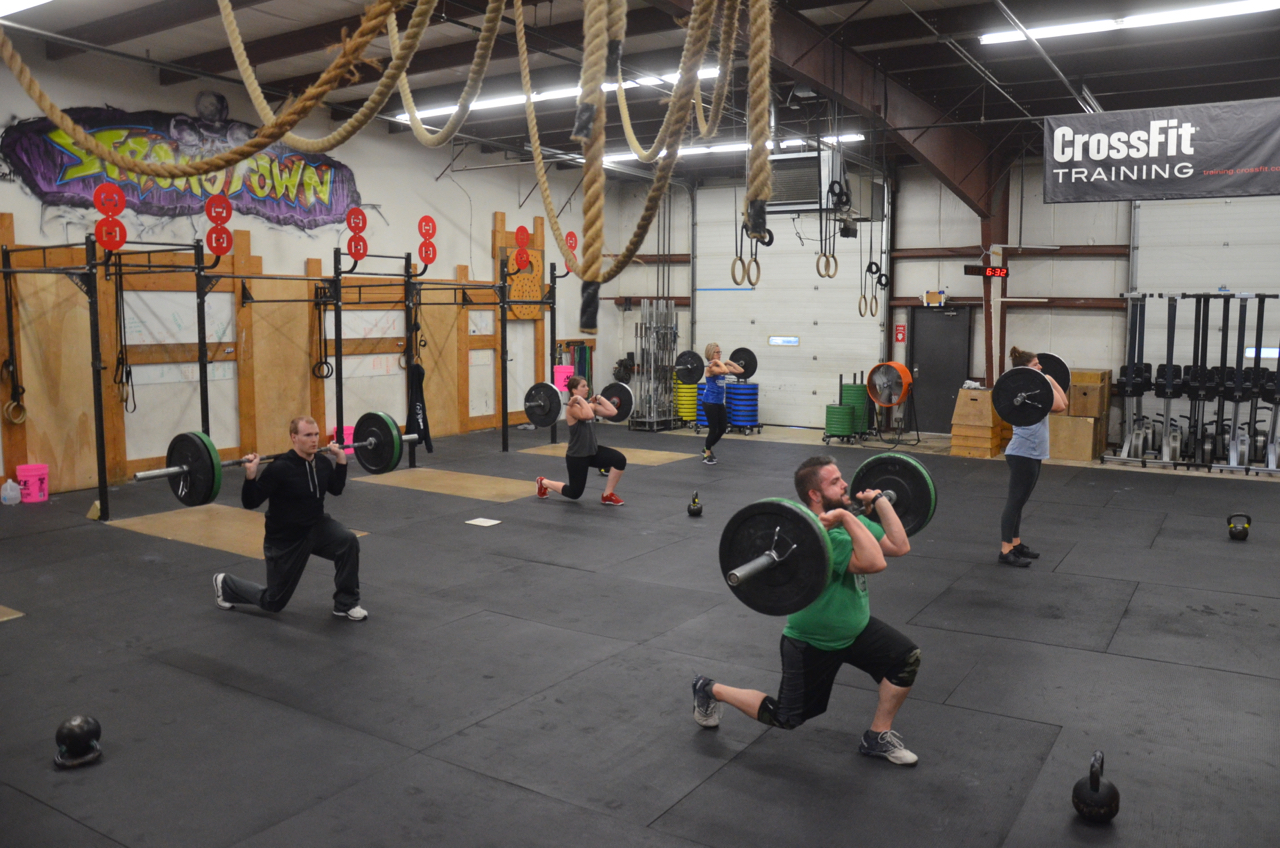 The 6pm class working through their Barbell lunges.
