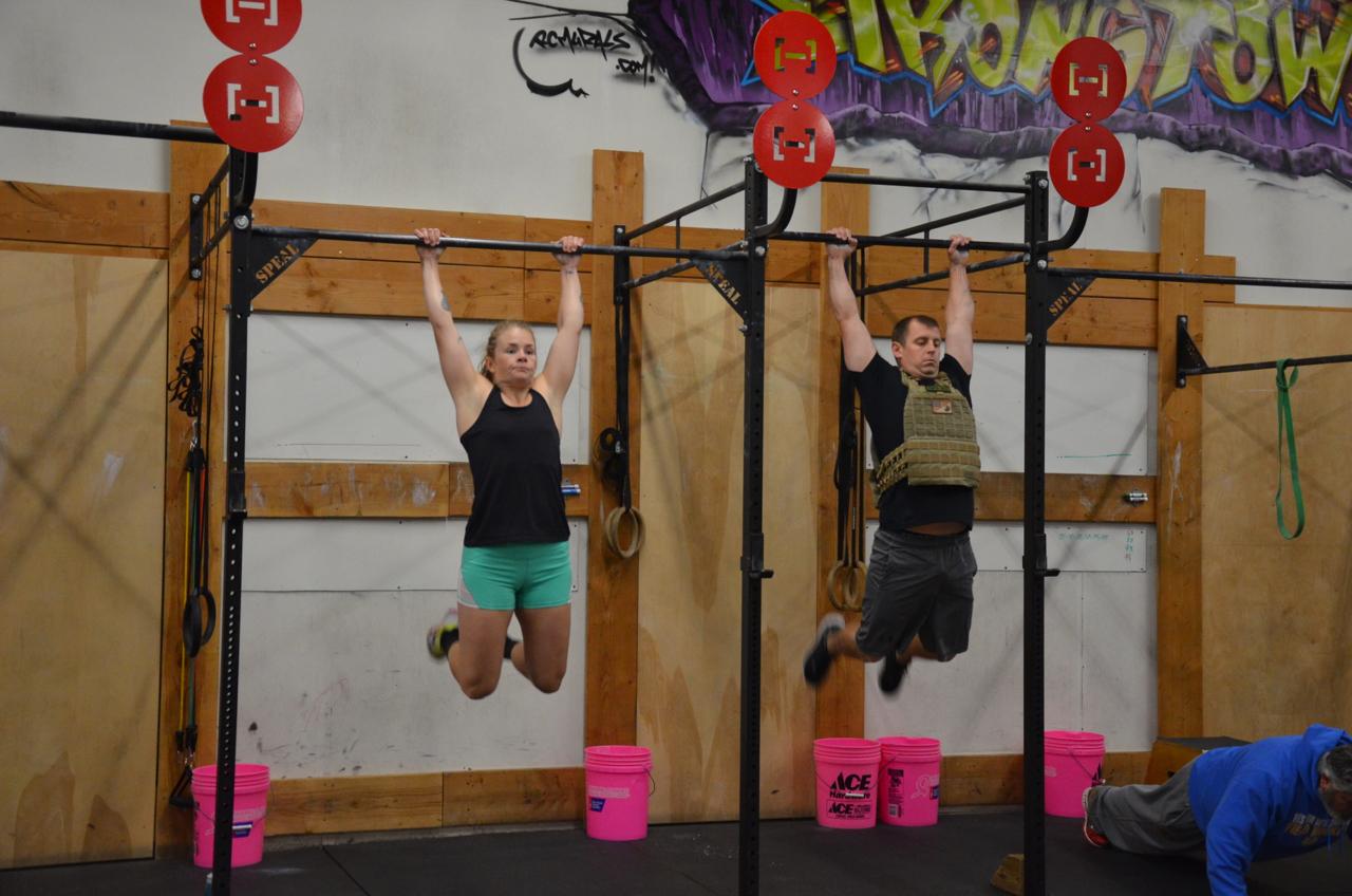 Heidi and Garrett during their pull-ups.