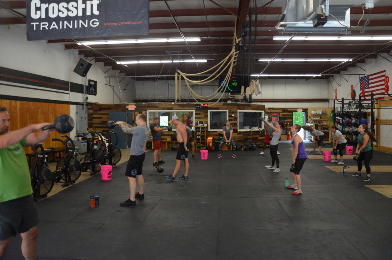 The 9:30am class on Friday working towards their max Russian KB swings.