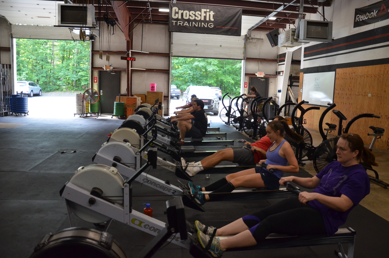 Coach Becky and the 10am Saturday class working through their 1,500m row.