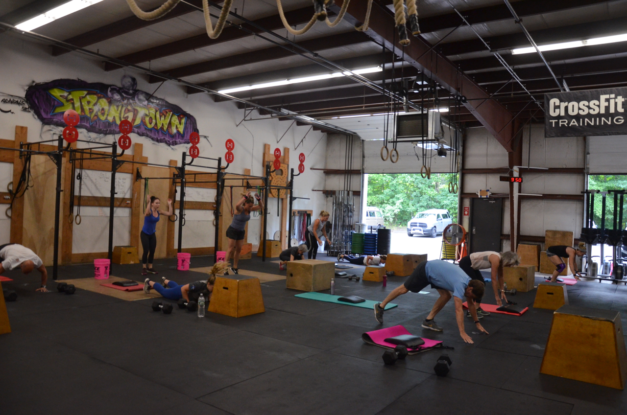 The 9:30am class working through their first round of burpees.
