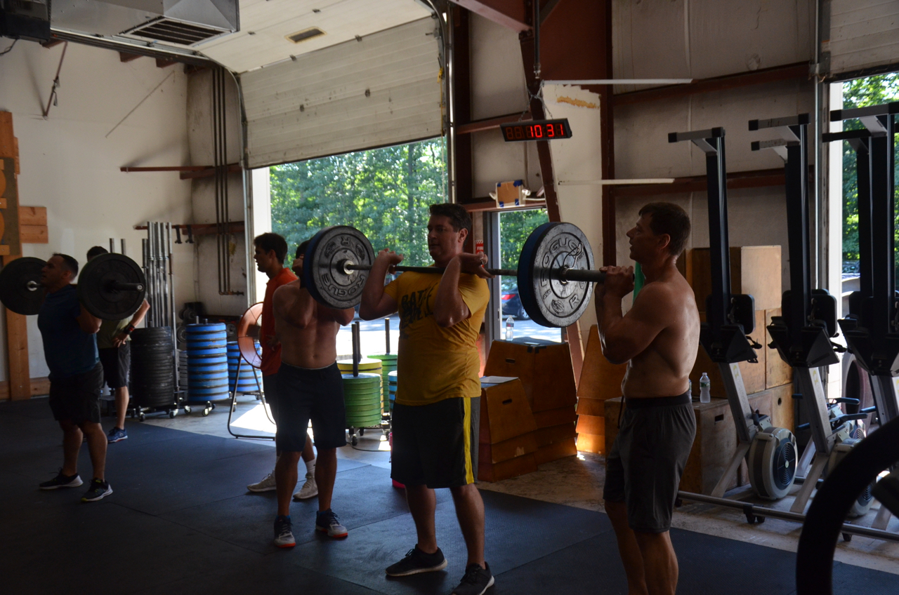 Team Barry, Brian, and Paul starting their barbell transition.