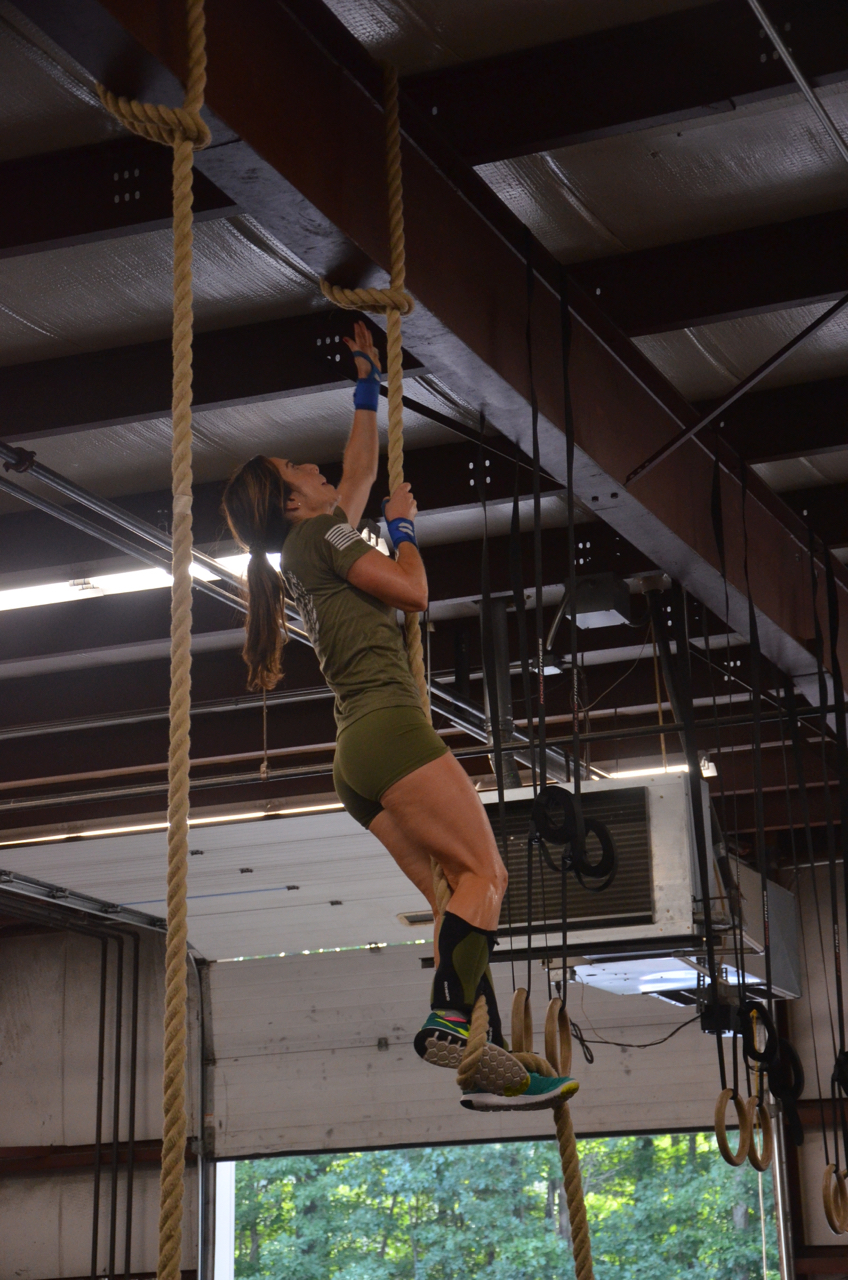 Holly making sure to hit the beam on her Rope Climbs.