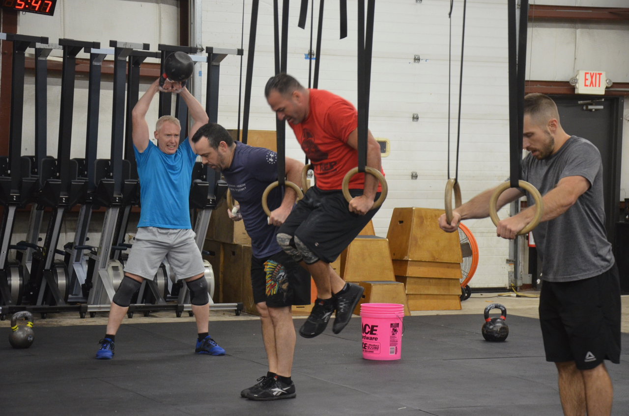 The 5pm guys working through their ring dips and swings.