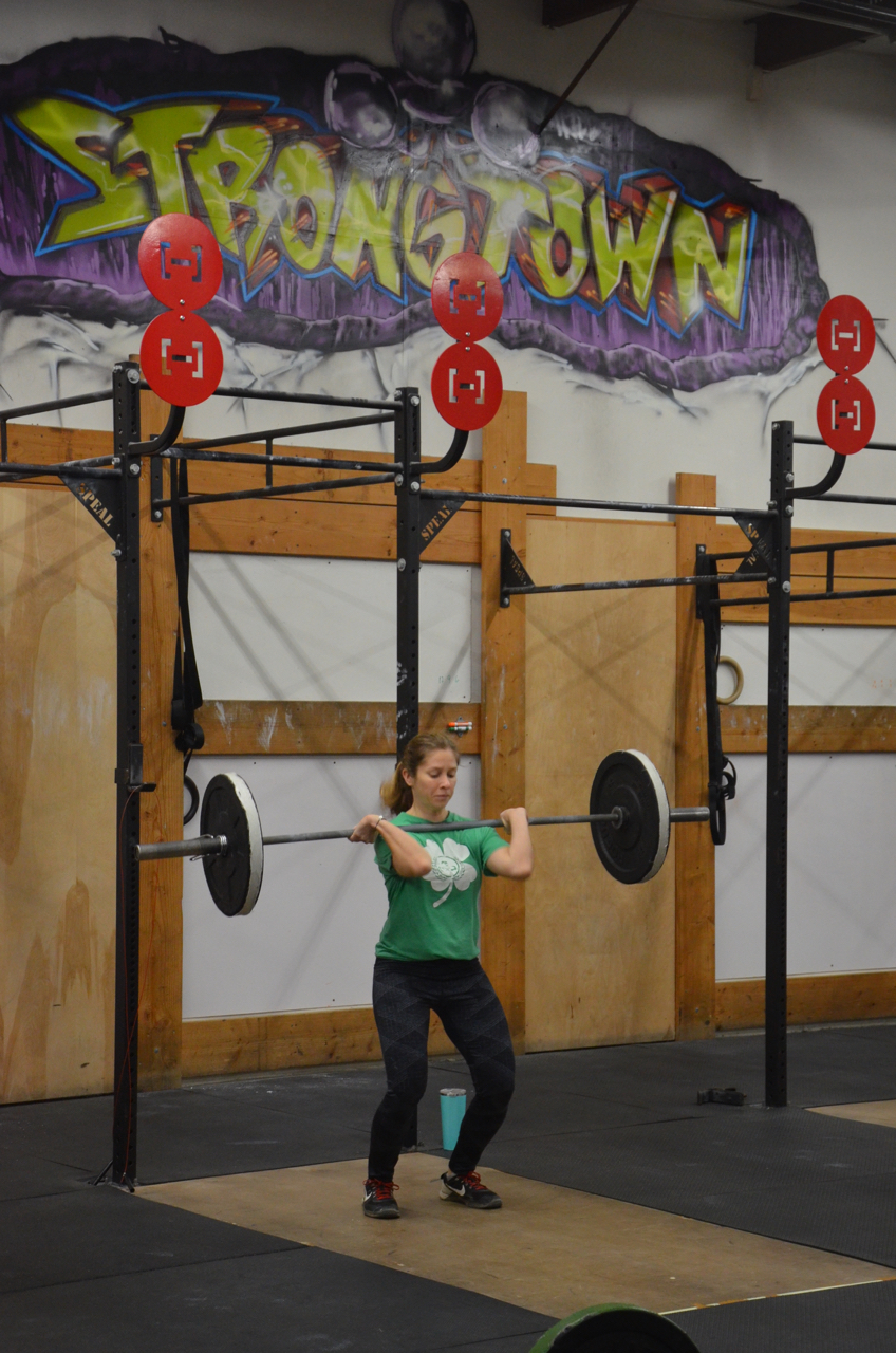 Sophia making sure to get her elbows around on her Hang Power Cleans.