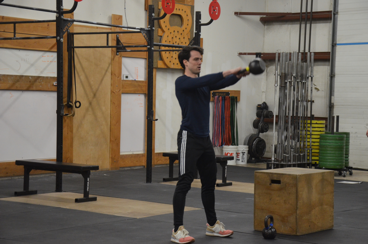 Angel staying focused during his Russian Kettlebell Swings.