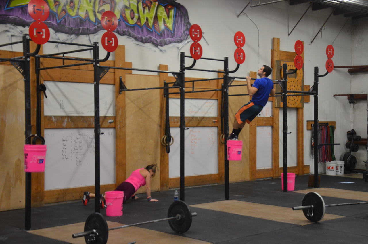 Sabrina and Kyle working through their Burpee Pull-ups.