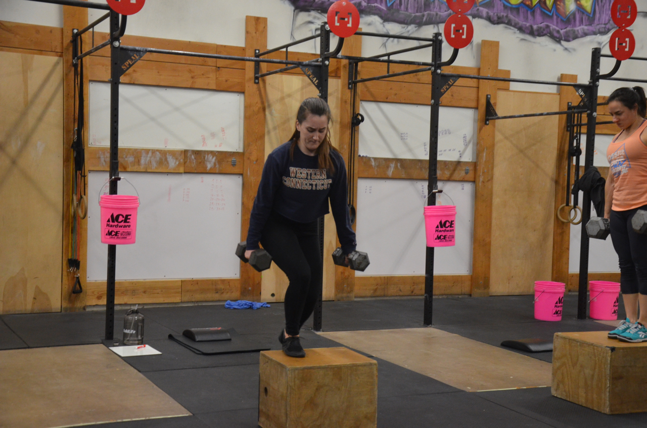 Mairead staying focused during the dumbbell burpee deadlift step-up.