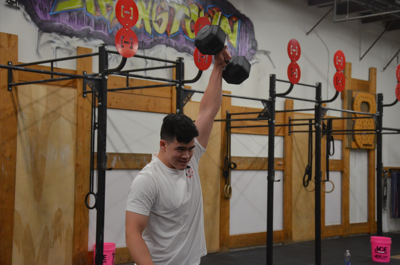 Dylan making the 50lb dumbbell look easy.