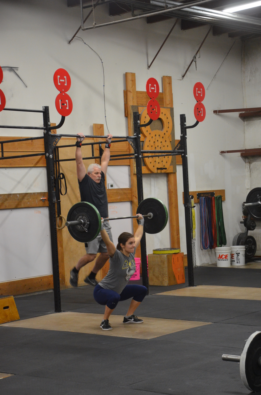 Kat staying focused during her 20 Overhead Squats.
