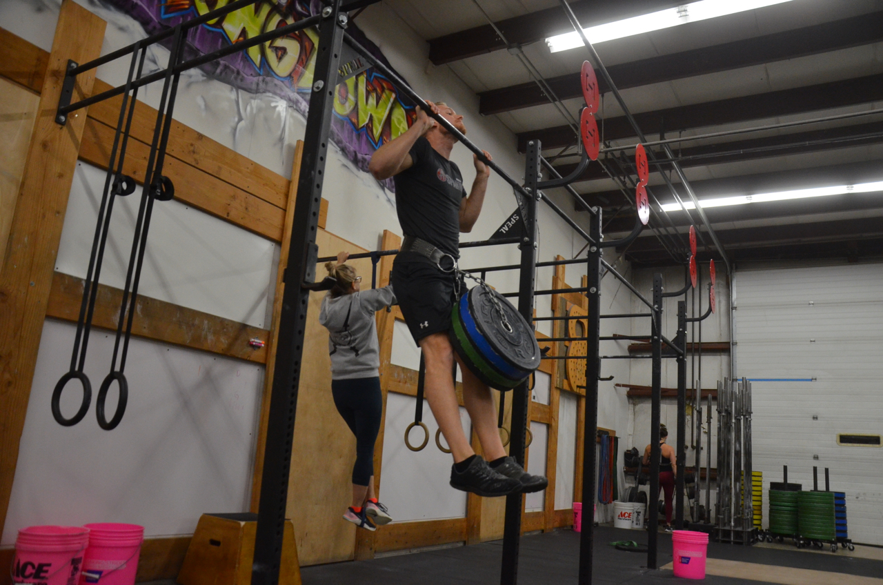 Tanner going 80 lbs for his 5x2 weighted pull-up.
