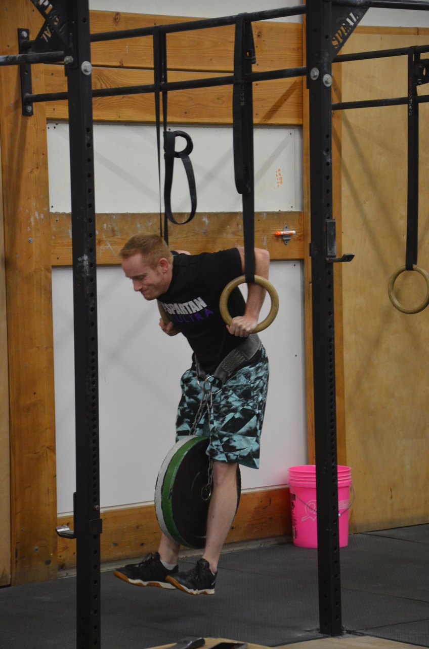 Chris using 40 lbs for his weighted ring dip work.