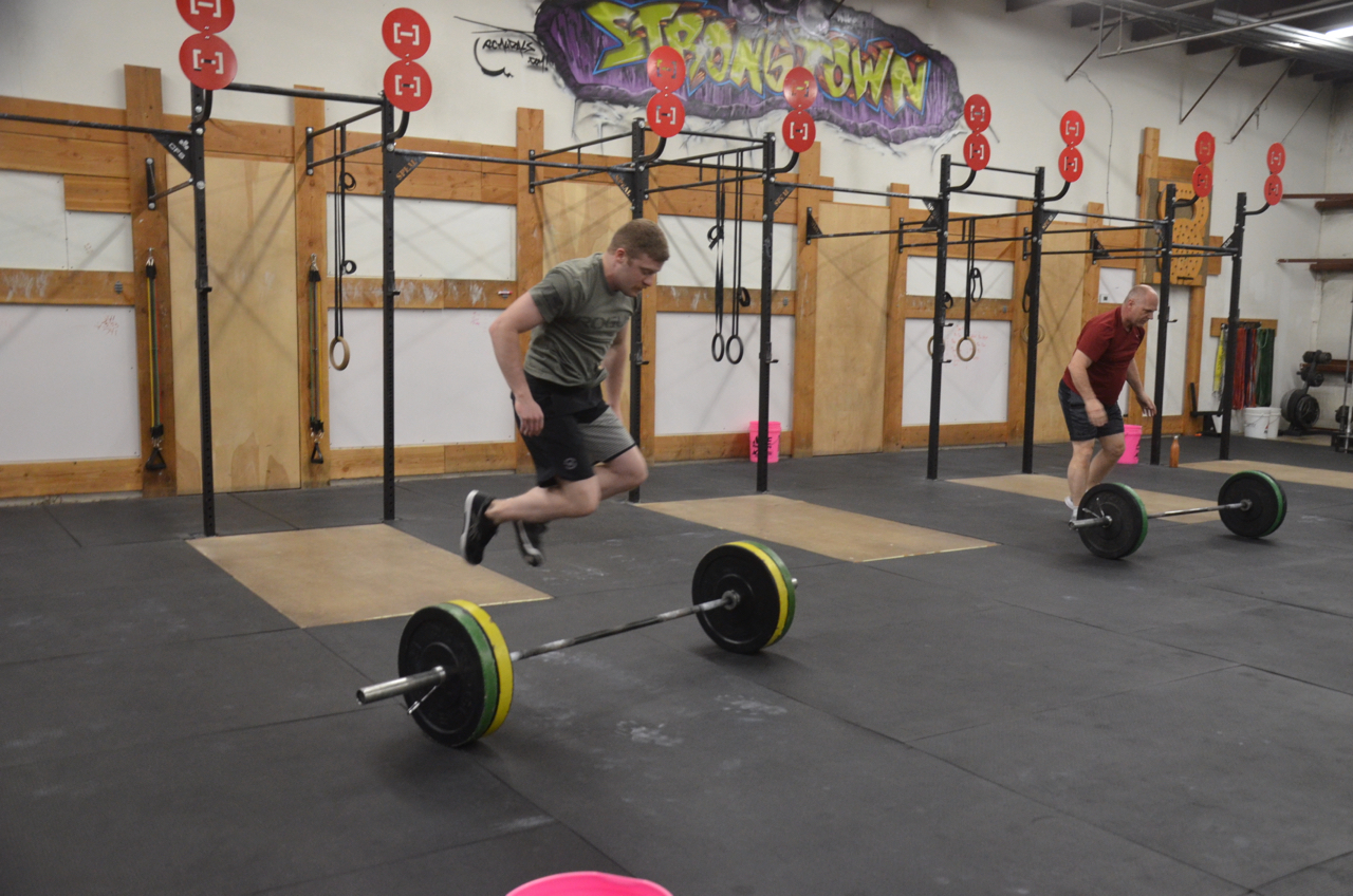 Liam and Dave during round 2 of bar facing burpees.