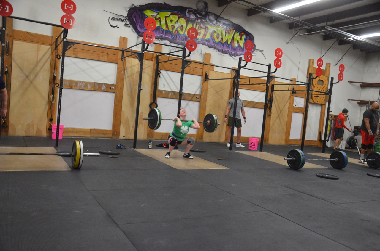 Caitlin working out of the bottom of her squat clean.