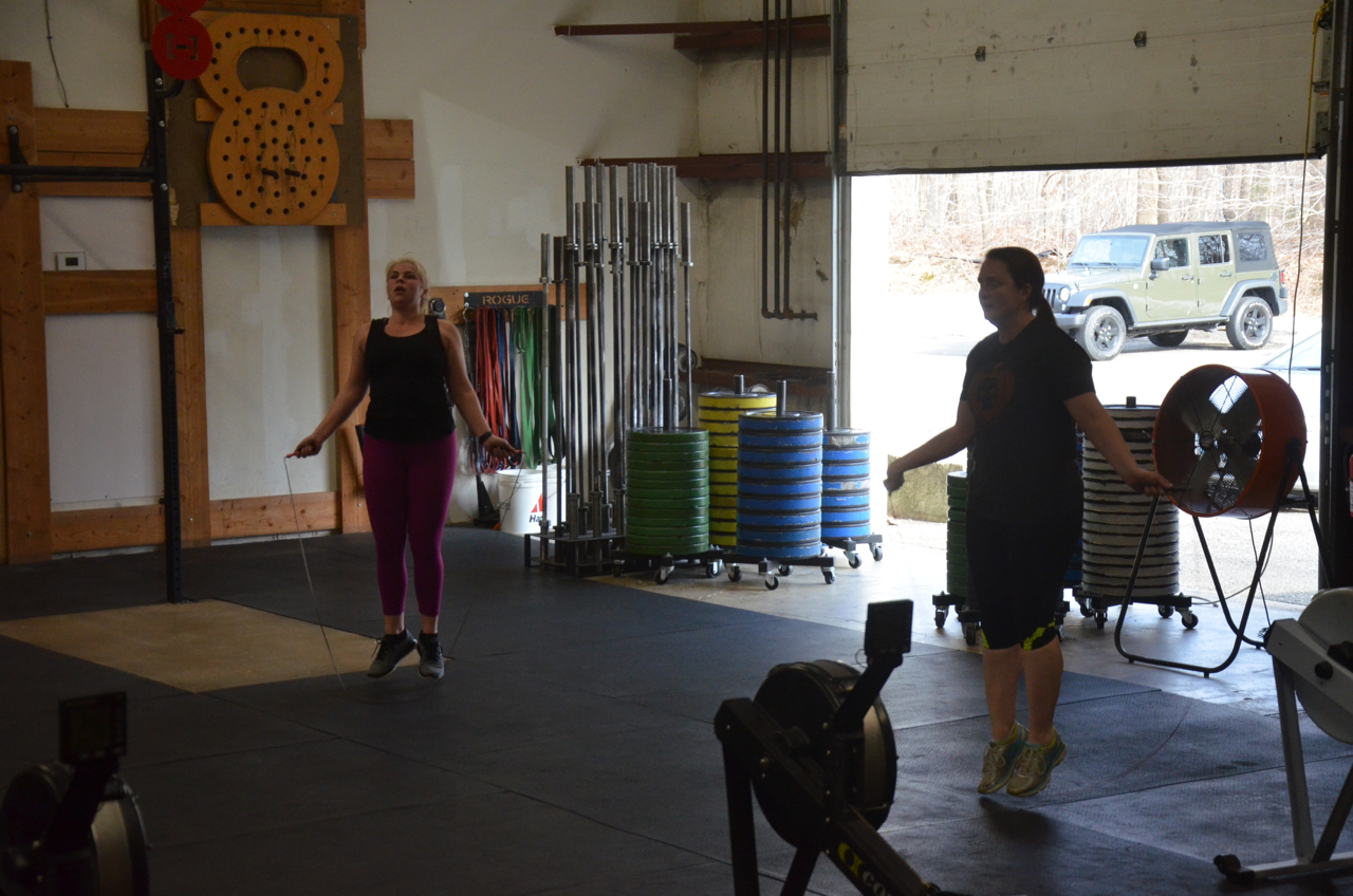 Kelly N. and Coach Becky working through one minute of double unders.