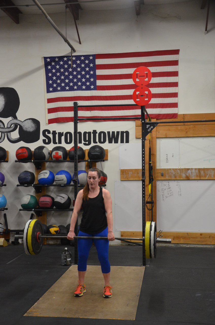 Mairead standing tall on her Deadlifts.