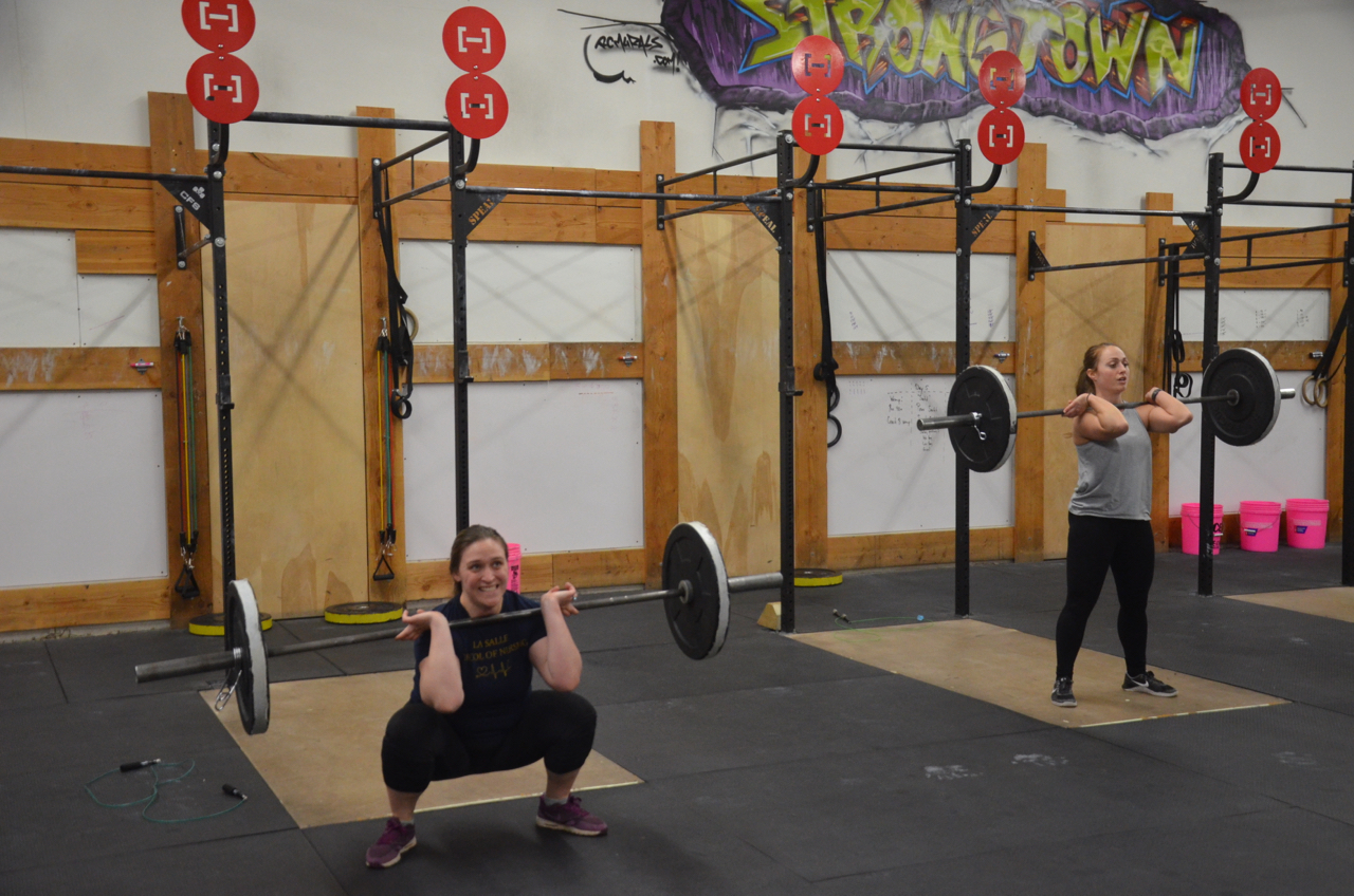 Sarah and Kosky working through their 14 front squats.