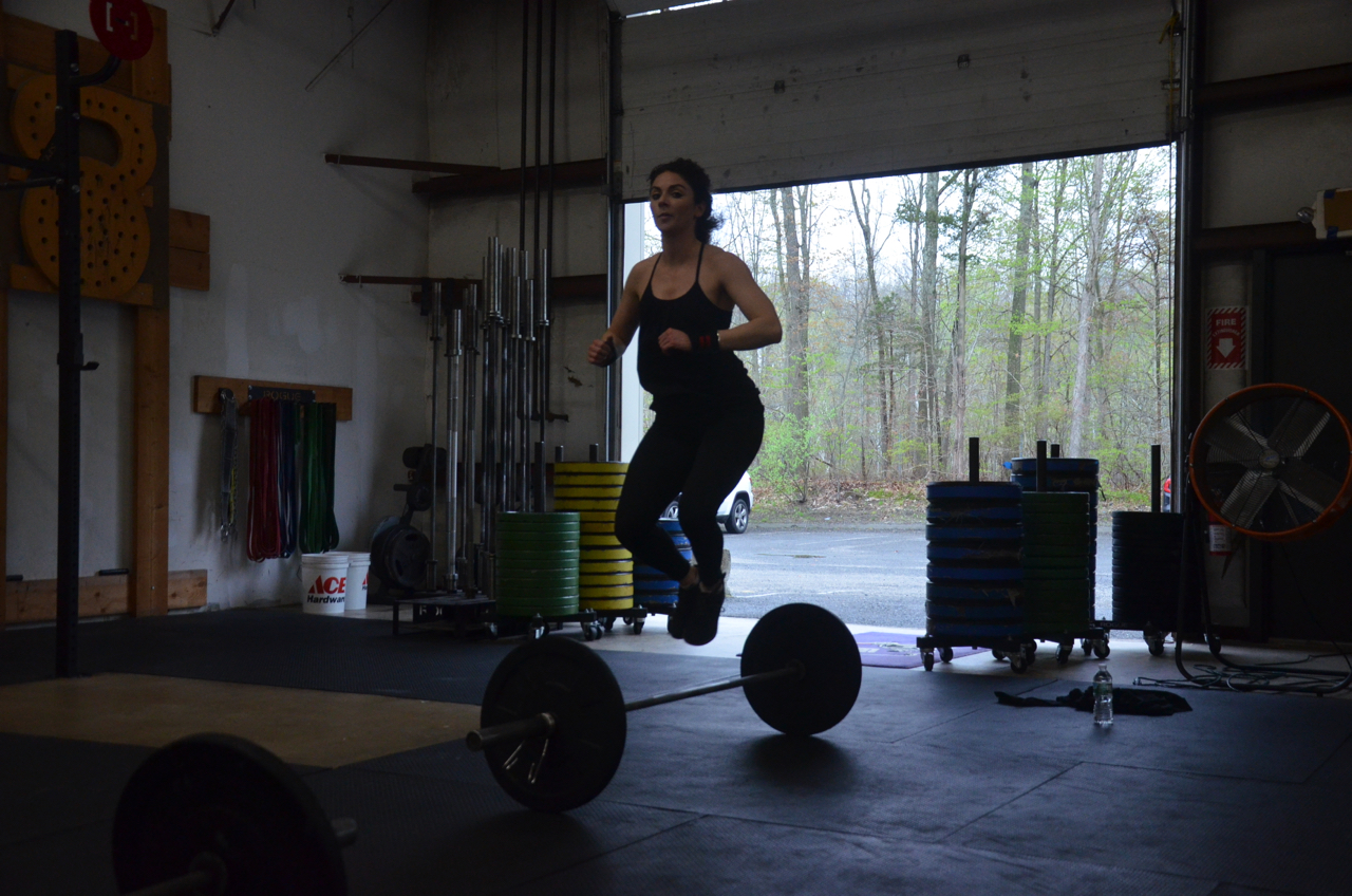 Krista showing some ups on her lateral bar burpees.