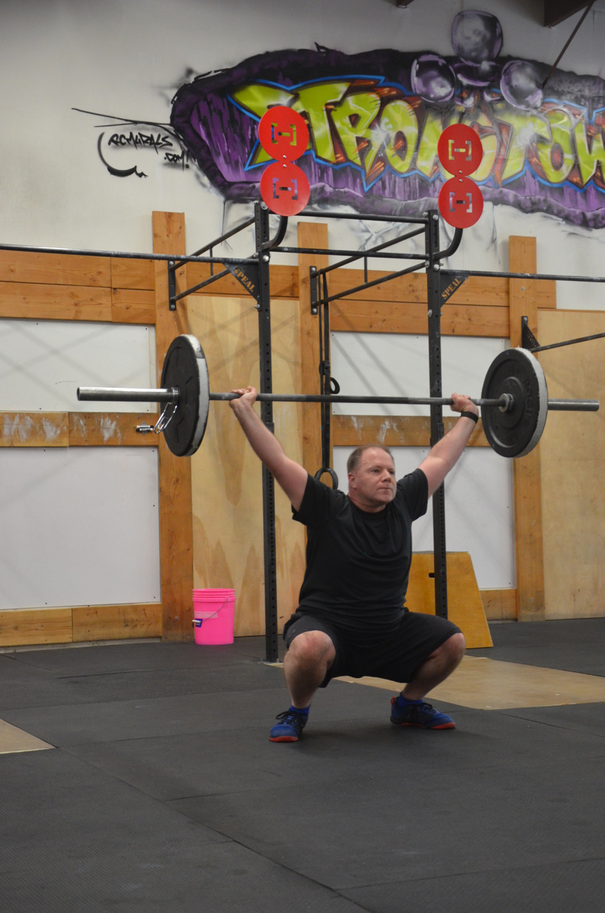 Dan working through his 12 Overhead Squats.