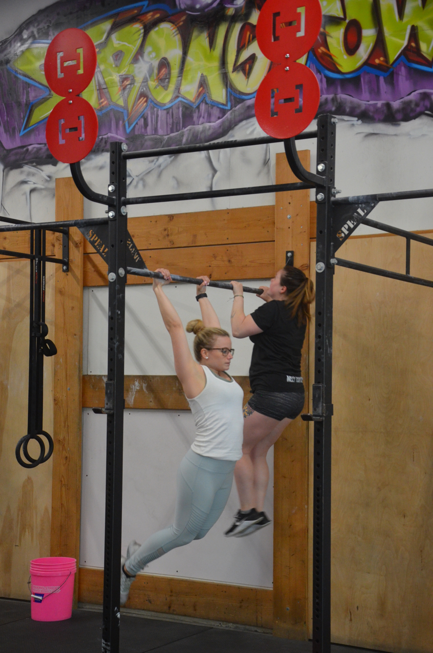 Lu and Tay Tay during their 12 pull-ups.