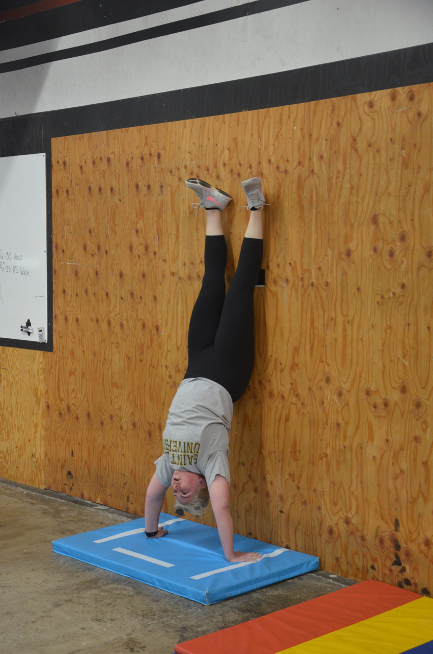 Kelly N. is becoming a lot more comfortable with the handstand hold.