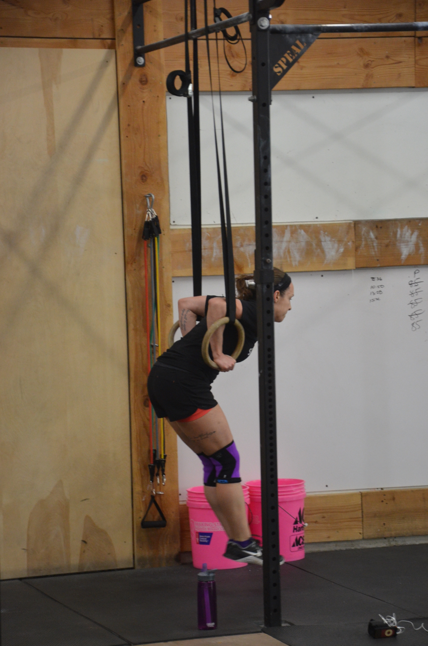 Coach Kelly working through 25 ring dips at the Saturday 9am class.