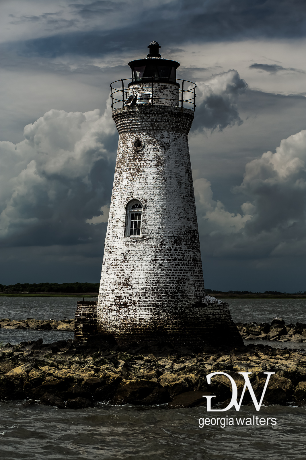 A storm brews behind the Cockspur Lighthouse.