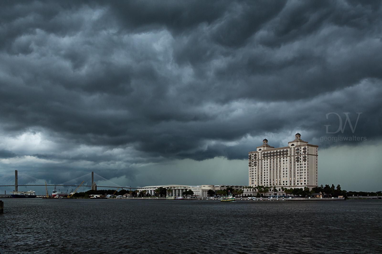 A storm brews over the Savannah River in Savannah, GA.