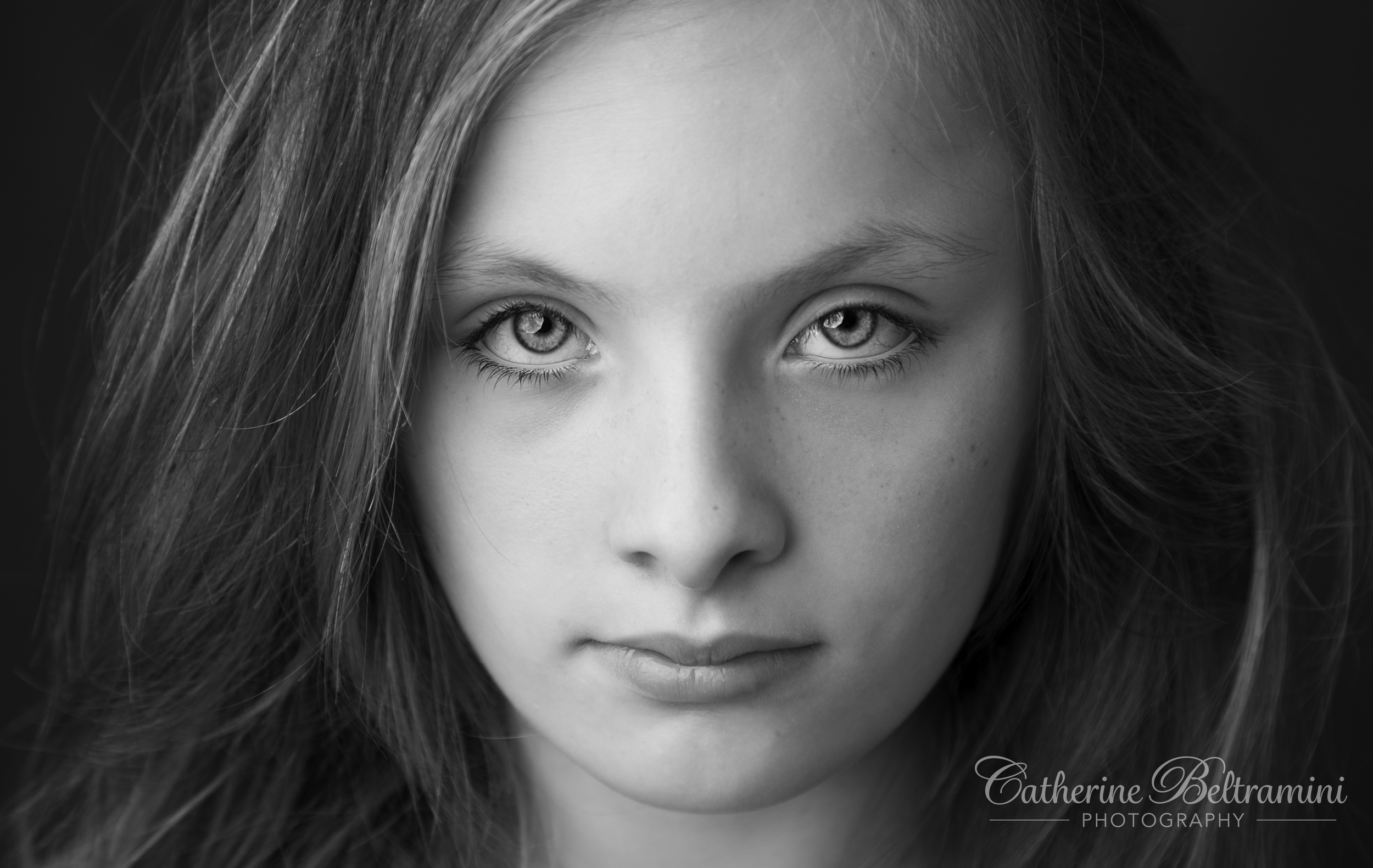 Moody black & white portrait of a beautiful young girl.