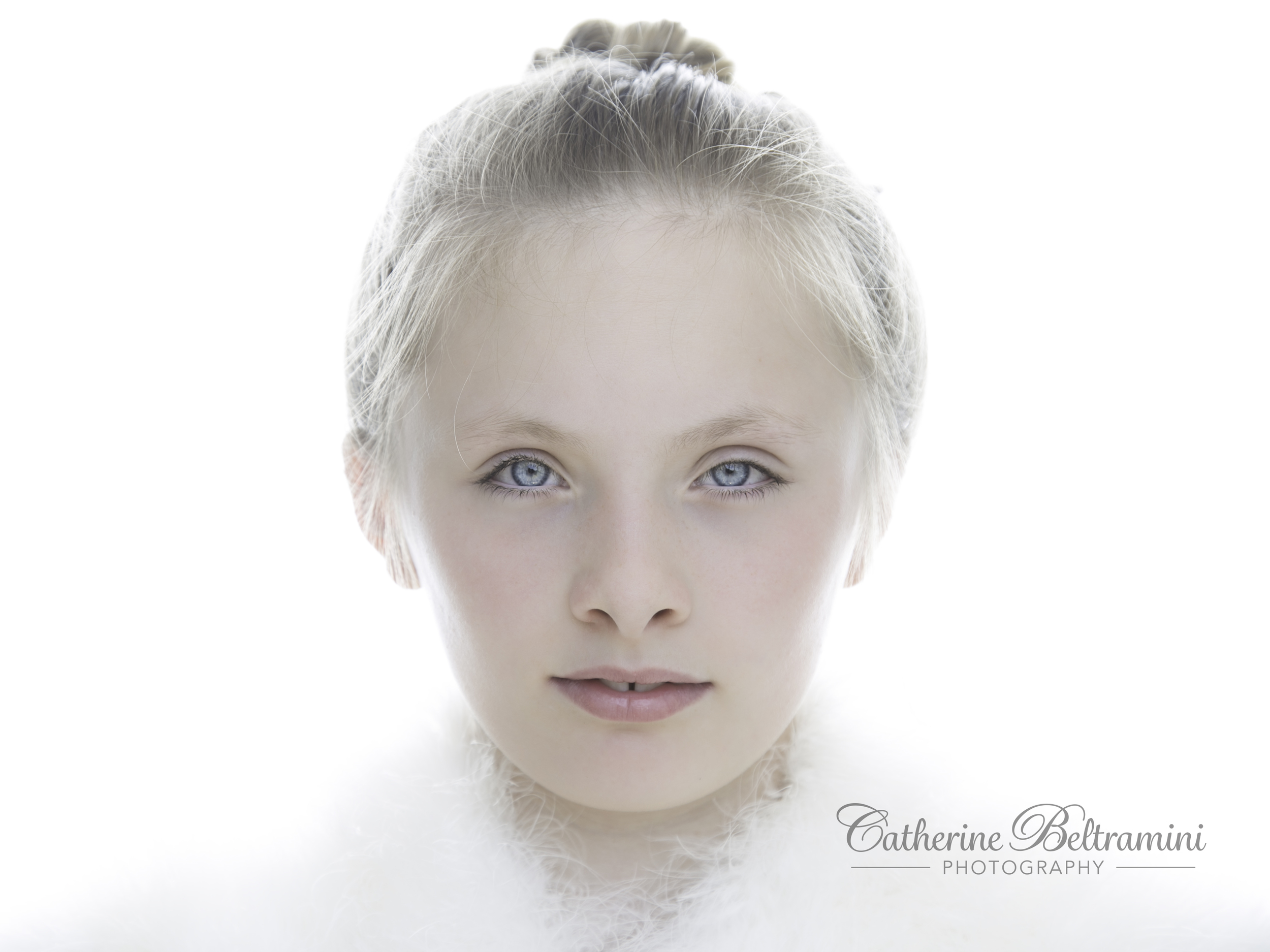 Snow queen high key portrait of a young girl.