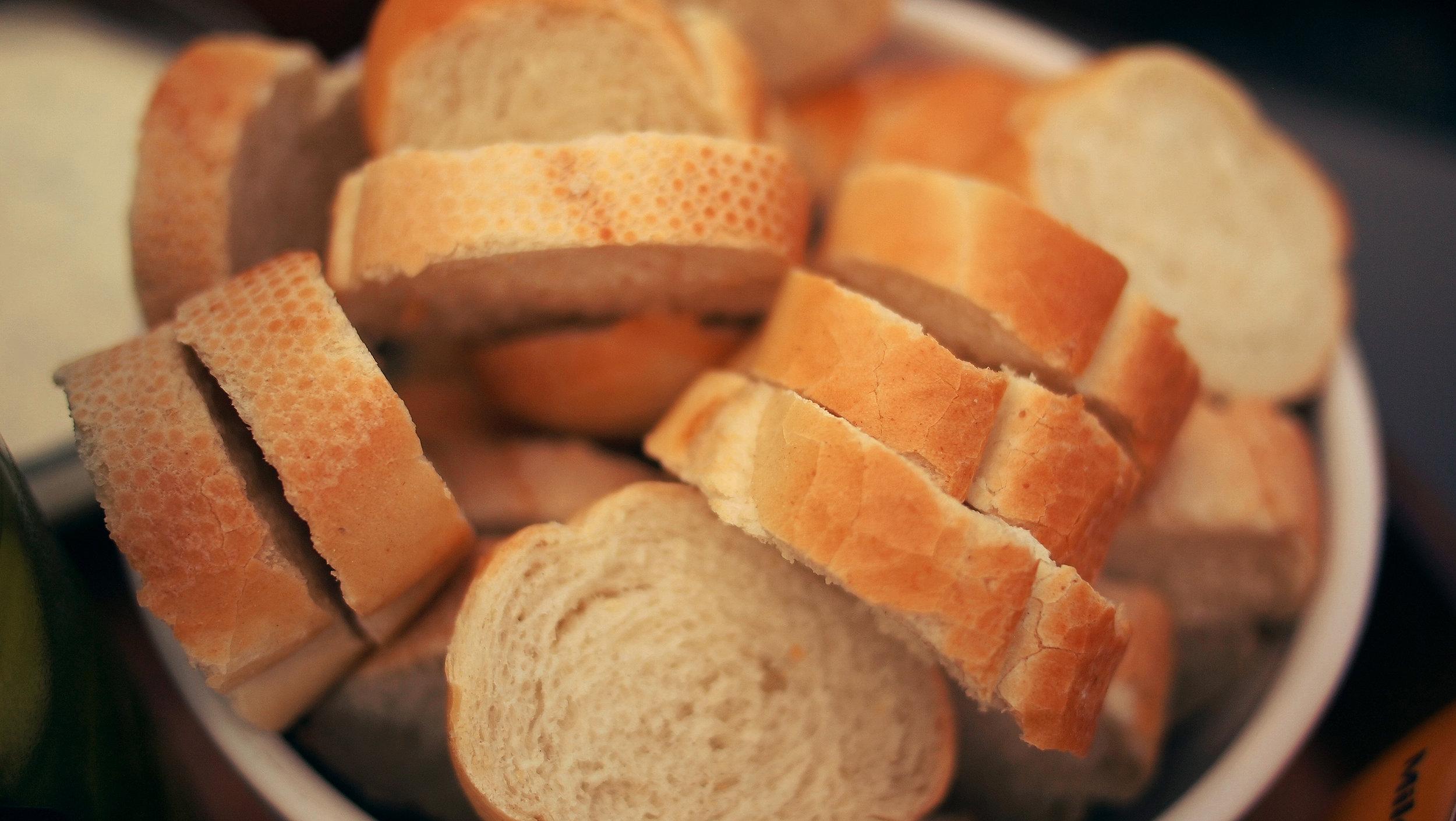 Volunteers pack bread into emergency food boxes.