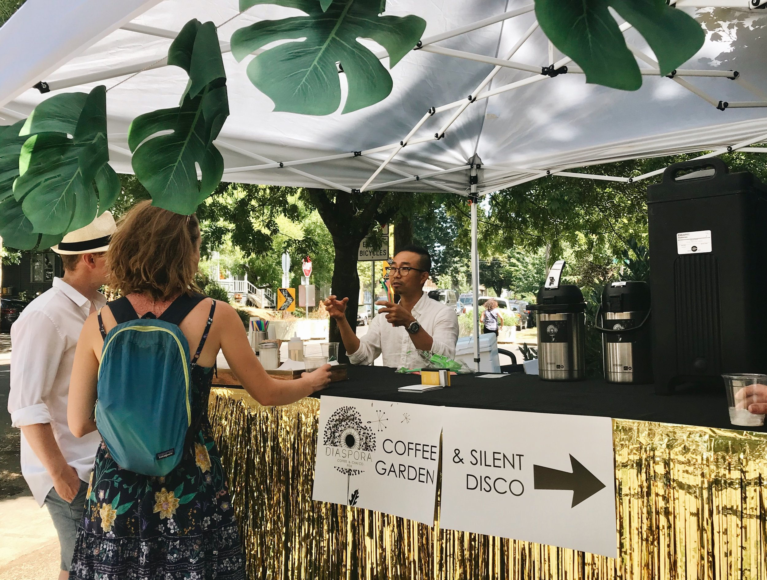 Sam at the Diaspora-hosted coffee garden at Imago Dei's Summer Baptism Festival.