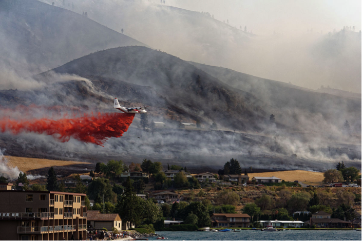 Phos-Chek fire retardant is dropped in Okanogan County, Washington in the summer of 2015. Creative commons image.