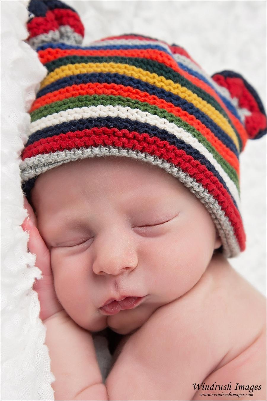 Sleeping newborn with teddy bear hat in Calgary