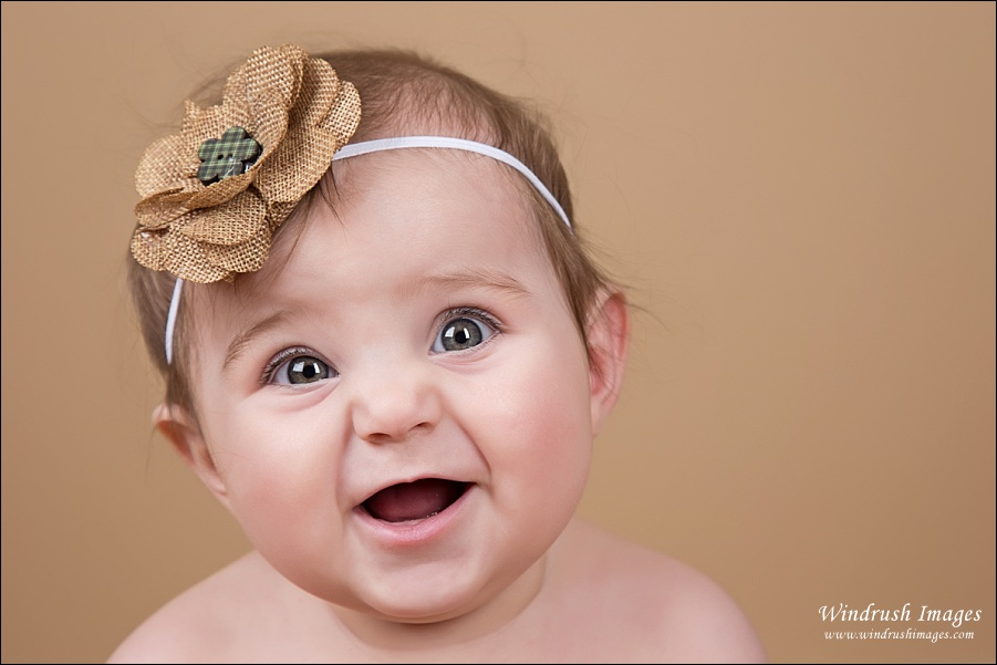 Adorable smiling baby girl photo by Calgary baby photographer