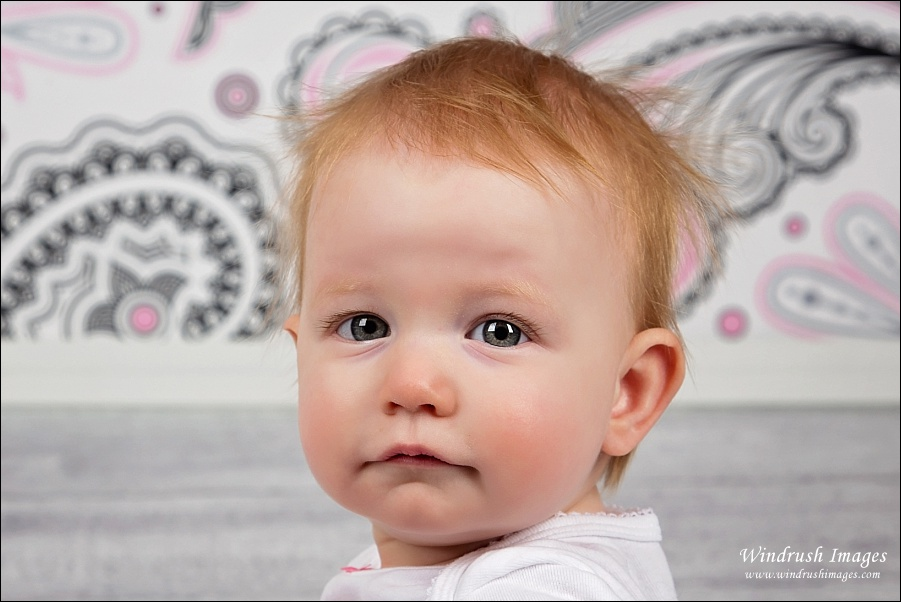 Sweet little girl with big eyes at one year old photo session in Calgary