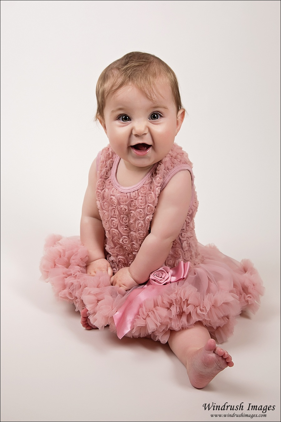 6 momth old baby girl in pink tutu dress for spring themed photos
