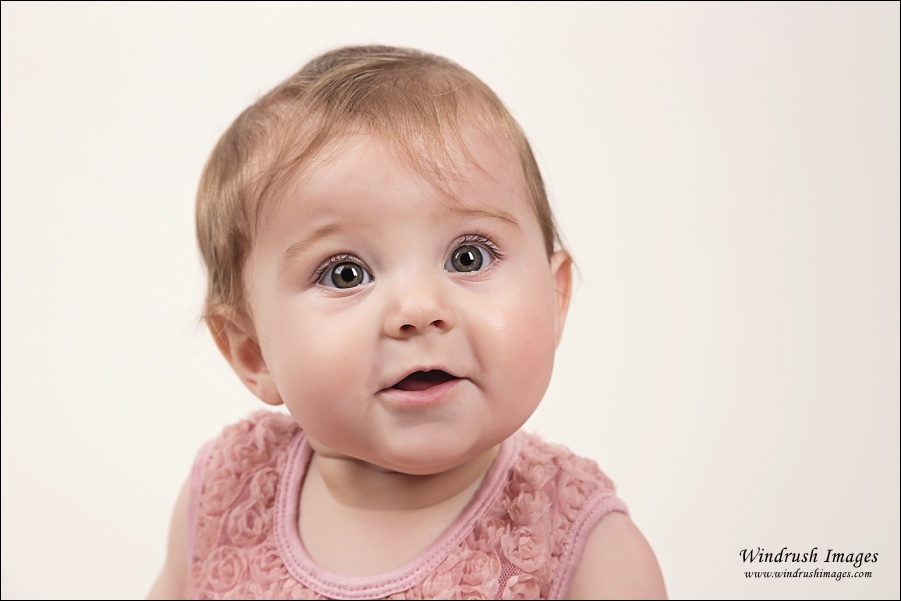 Close up picture of beautiful baby girl with lovely hazel eyes