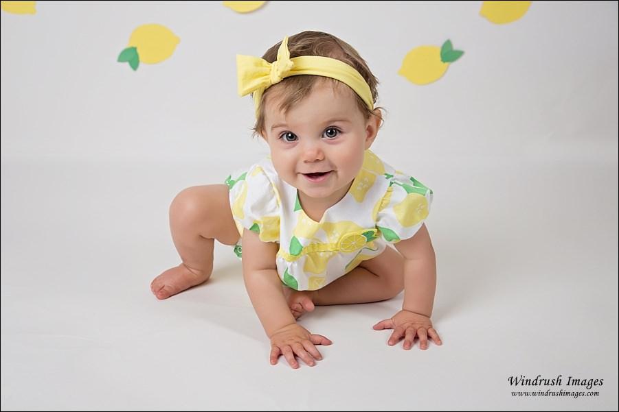 baby-girl-getting-ready-for-lemonade-themed-cake-smash-at-Windrush-Images-Calgary-portrait-studio