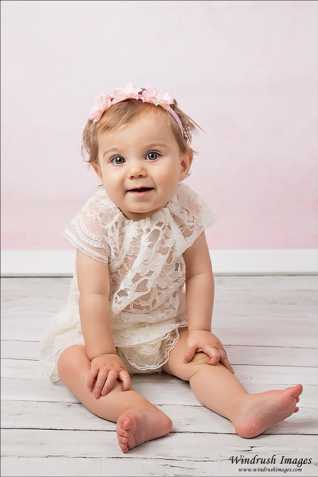 Calgary-studio-one-year-photography-session-little-girl-with-pink-background.jpg