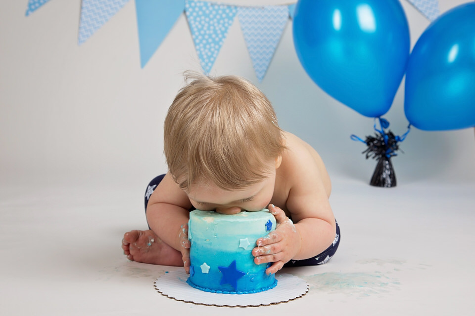 Cake-smash-photo-shoot-Calgary-boy-with-head-down-into-birthday-cake